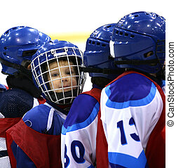 Young hockey player - Portrait of the young hockey player in...