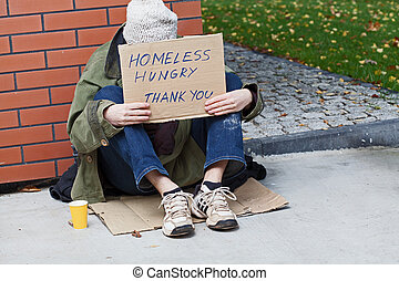 Young homeless male begging for help - Young poor beggar...