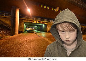 sad redhead boy standing on a lonely dark street