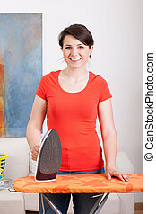Young housewife during ironing