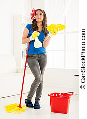 Young Housewife With Cleaning Equipment - Young housewife...