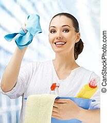 Young housewife - Young girl with a pack of detergents