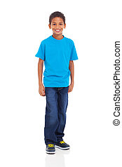 young indian boy standing on white background - happy young...