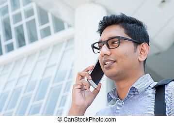 Indian business man talking on phone