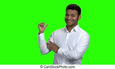 Young Indian businessman pointing at copy space. Handsome...