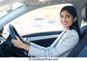 young indian businesswoman driving a car