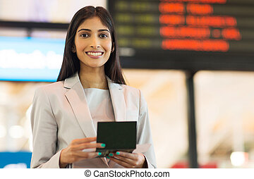 young indian businesswoman holding passport