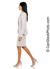 young indian businesswoman walking