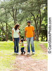 young indian couple with baby boy walking outdoors
