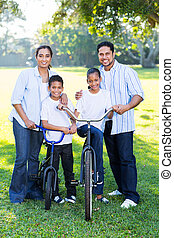 young indian family of four