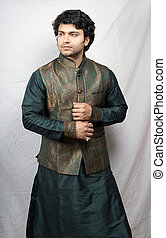 young indian male model in artistic green kurta side pose