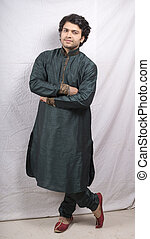 young indian male model in green kurta front pose