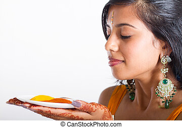 young Indian woman holding spices - young Indian woman...