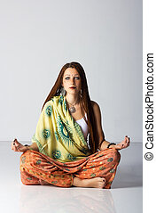young indian woman posing sitting on the floor