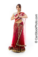 Young Indian woman standing in prayer position