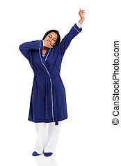 young indian woman yawning and stretching before bedtime - ...