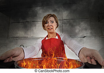 young inexperienced home cook woman in panic with apron holding pot burning in flames with stress and panic face expression in fire in the kitchen and amateur newbie rookie ad messy cooking concept