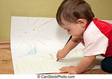 Young inspired artist - A thoughtful baby boy is sitting on...