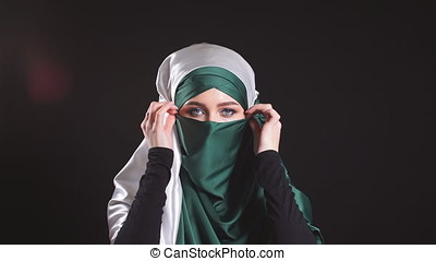 Young Islamic woman in national costume posing for the camera.