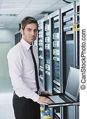 young it engeneer in datacenter server room - young handsome...