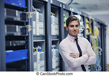 young it engineer in datacenter server room