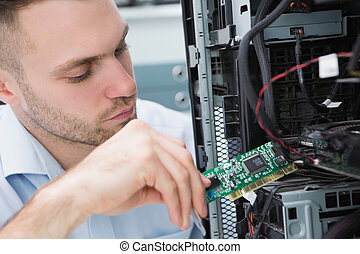 Young it professional fixing computer problem - Close-up of...