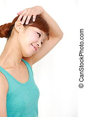 neck stretch - young Japanese woman doing neck stretch at ...