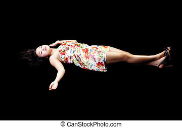 Young Japanese Woman Reclining In Dress Black Background