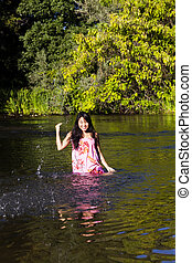 Young Japanese Woman Splashing River Dress Smiling