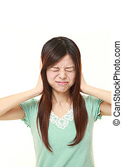 Young Japanese woman suffers from noise