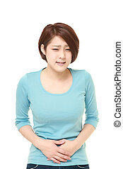 young Japanese woman suffers from stomachache