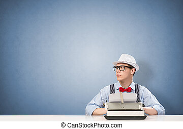young journalist - image of a young journalist, sitting at...