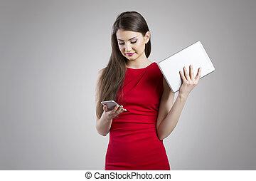 Young joyful woman in red dress