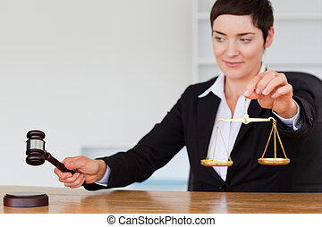 Young judge with a gavel and the justice scale