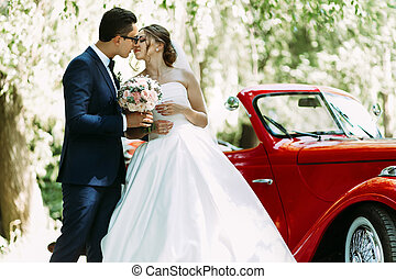 Young just married couple in the sunny day