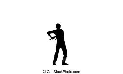 young karate or taekwondo man expertly twirling nunchaku, silhouette, Slow motion