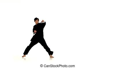 young karate or wushu makes rack on a white background, on a...