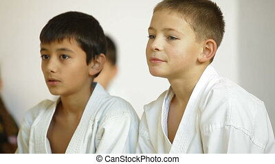 Young karate students learning