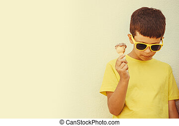 Young kid boy child eating ice cream.