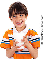 Young kid holding a glass of milk