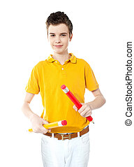 Young kid holding two big colorful pencils