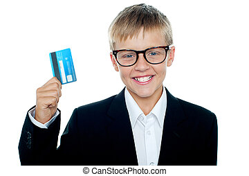 Young kid in business suit flaunting a debit card. Wanna go...