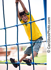 Young kid on playstructure