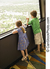 Young kids at window.