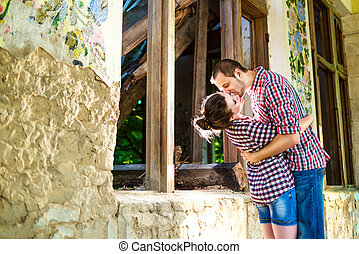 Young kissing happy couple in love in summer sunny evening.