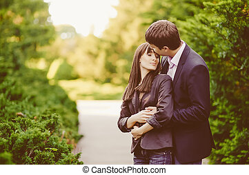 Young kissing happy couple in love