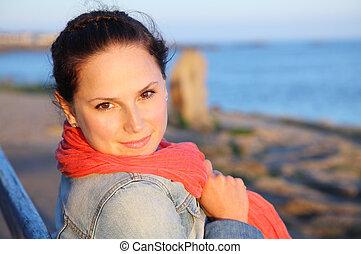 Young lady at the sea coast