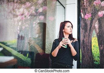 young lady drinking coffee - Beautiful girl drinking coffee...