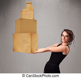 Young lady holding a set of brown cardboard boxes -...