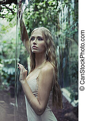 Young lady imprisoned in giant soap bubble